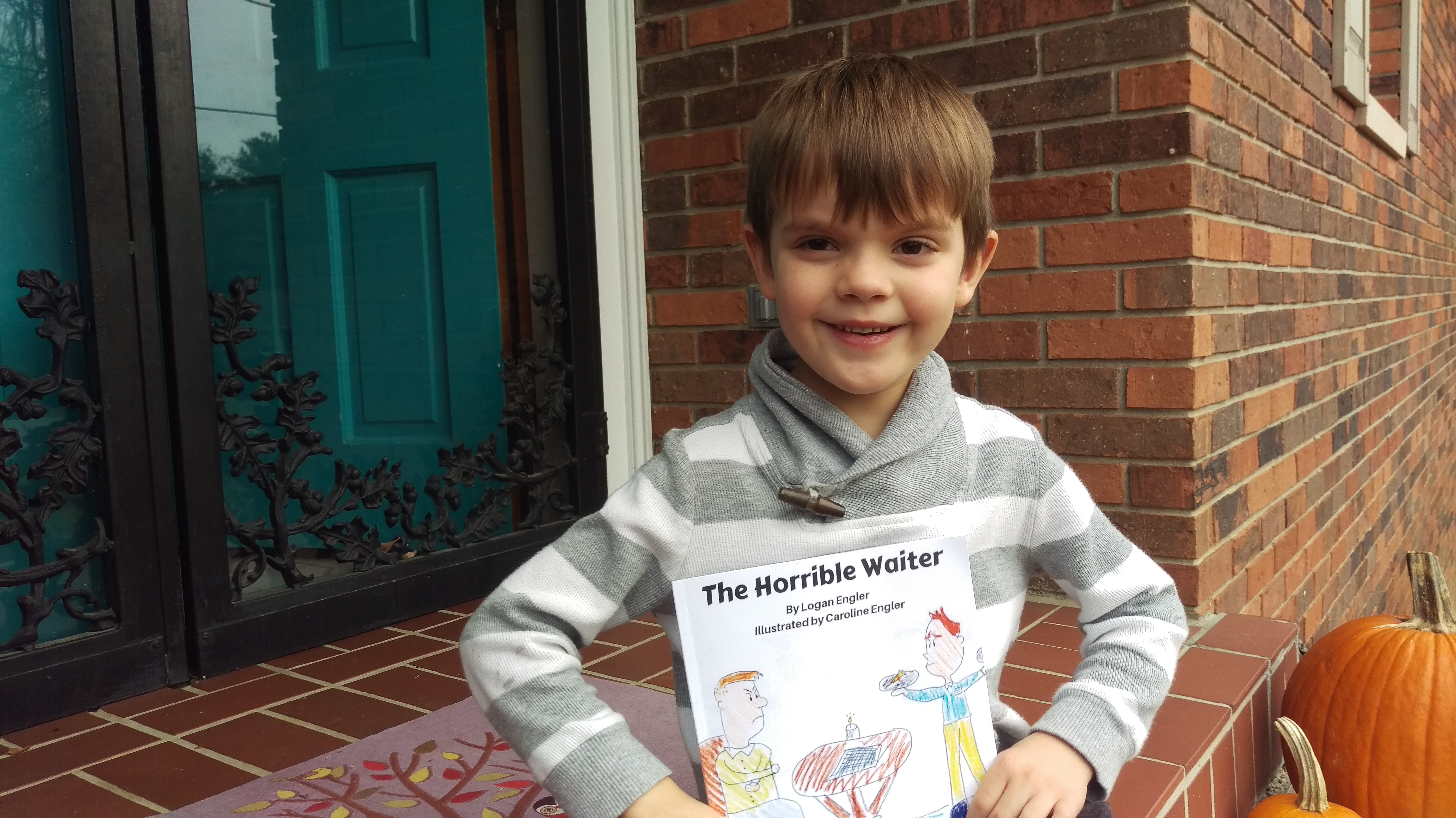My son Logan poses with his first book!